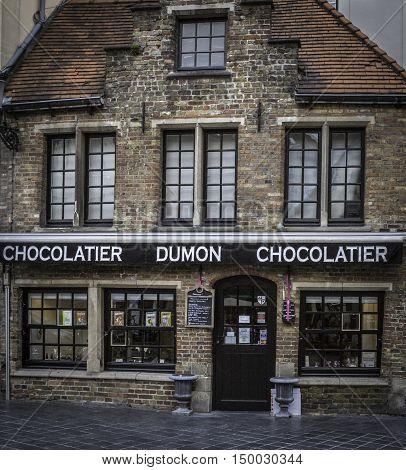 BRUGES, BELGIUM - MAY 12, 2016: Famous for its Belgian chocolate, Dumon Chocolatier is a popular tourist destination.
