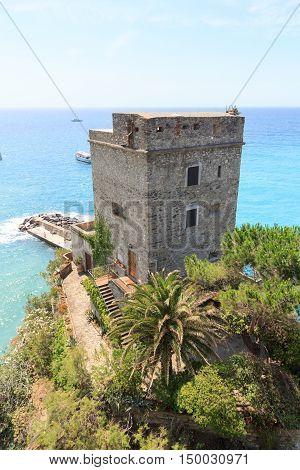 Dawn tower Torre aurora in Cinque Terre village Monterosso al Mare and Mediterranean Sea Italy