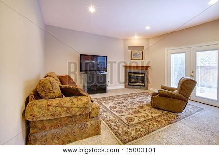 Living Room With Fireplace, Sofas And Tv