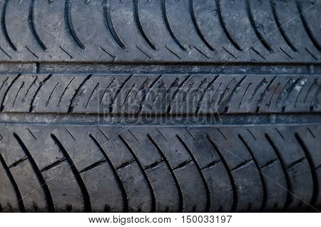 Closeup texture of a car tyre old