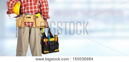 Hand of handyman with a tool bag.