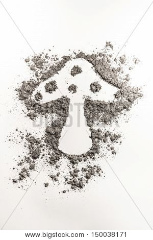 Fungus shape drawing in a pile of grey dust sand ash dirt