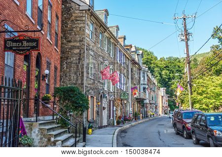 JIM THORPE PENNSYLVANIA - SEPTEMBER 28: Historic row homes with shops on Race St. on September 28 2016 in Jim Thorpe Pennsylvania.