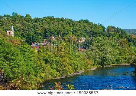 Historic architecture on the mountainside overlooks the Lehigh River in scenic Jim Thorpe Pennsylvania.