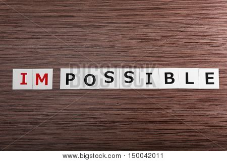 Turning word impossible into possible
