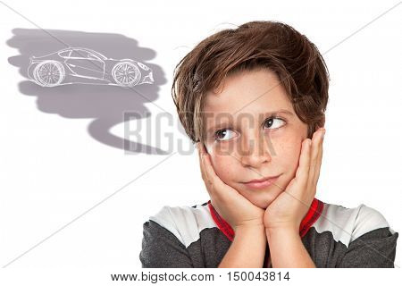 Closeup portrait of a cute teen boy dreaming about a car, thoughtful child isolated on white background, great boyish wish