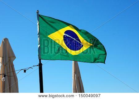 Brasil flag on the beach in Brasil