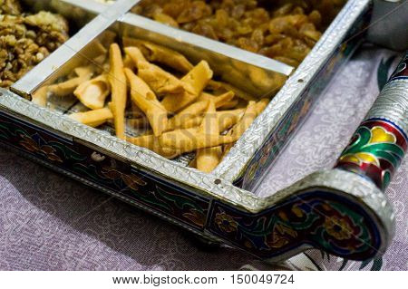 Indian snacks and dry fruits are a popular serving to guests during festival time. These are typically served in beautiful handicraft trays