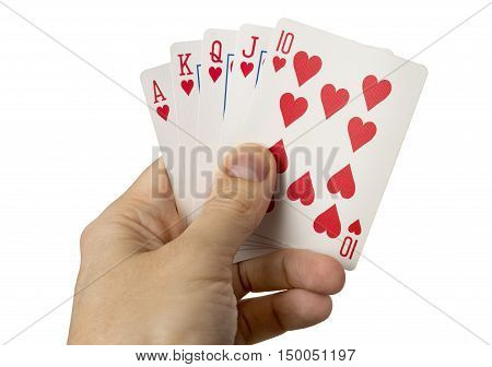 close up of man hands with royal flush of hearts isolated over white