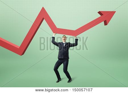 Businessman lifts red arrow up. Help and support from investors. Increase in income. All in your hands. Diligence and effort.