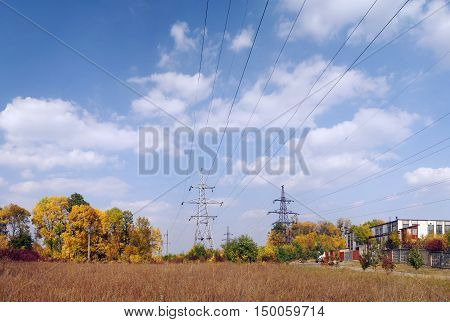High voltage powerline transmission towers - autumn landscape (power supply ukrainian oblenergo sale)