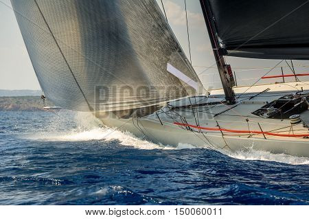 Racing sailing yacht going fast in the Mediterranean sea. Sardinia island race, Italy