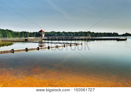 Alum Lake 'Kamencove jezero' in Chomutov city with wooden pier at the end of the summer tourist season