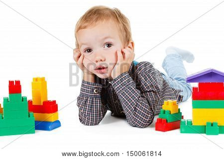 little boy play with toy and build house isolated on white background
