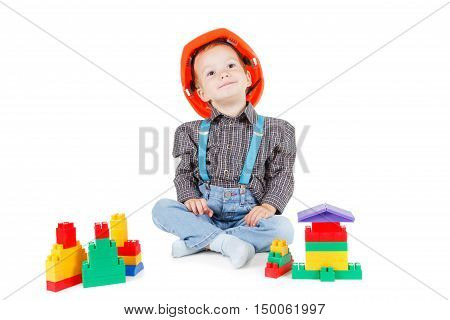 little boy in a red protective hardhat helmet isolated on white background