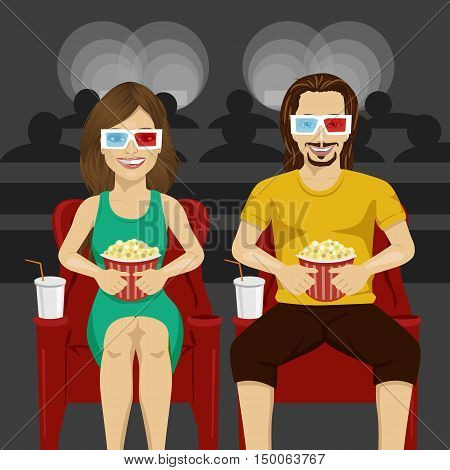Happy couple sitting in movie theater watching 3D movie, eating popcorn and smiling