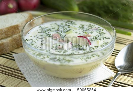 Summer cold soup with fresh vegetables. Russian cold soup - okroshka. National russian summer dish.