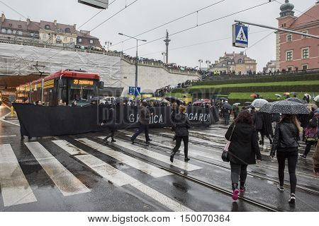 WARSAW POLAND - OCTOBER 03 2016: Polish women donned black boycotting jobs and classes as part of a nationwide strike to protest a legislative proposal for a total ban on abortion.