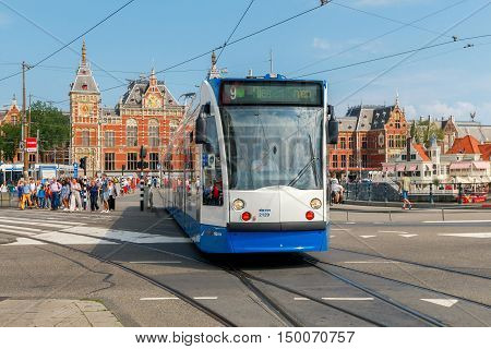 Amsterdam. Netherlands - August 26 2016: Tram in front of the main train station of Amsterdam. It is the largest train station in Amsterdam. And the main transport hub.