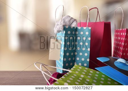 Shopping Bags With New Clothes Inside In A Shop Front