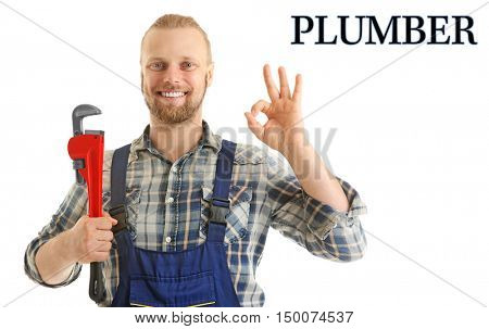 Plumbing concept. Portrait of handsome plumber with pipe wrench isolated on white
