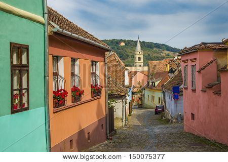 Beautiful traditional street inside citadel of Sighisoara (house of Dracula) in Transylvania region Romania