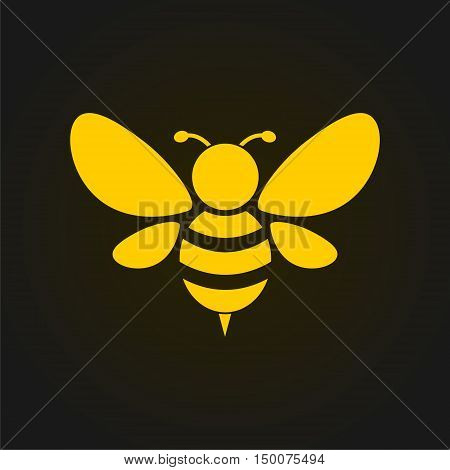 Vector golden bee icon on black background. Abstract bee silhouette