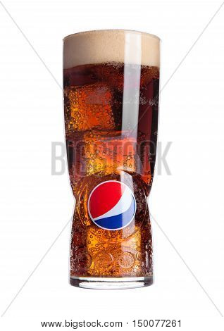 LONDON, UNITED KINGDOM-OCTOBER 03 2016: Original large glass with pepsi cola and ice cubes and foam isolated on white. Pepsi is a carbonated soft drink that is produced and manufactured by PepsiCo. Created and developed in 1893.