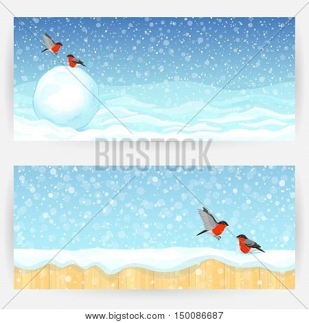 Festive winter backgrounds with bullfinches snow, snowball and wooden fence. Horizontal banners