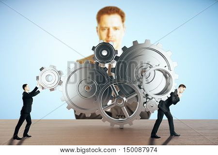 Two businessmen pushing and dragging abstract gear mechanism on blue background with another businessman watching them. Supervision concept. 3D Rendering