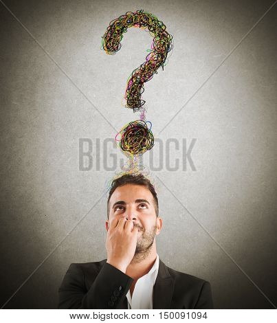 Businessman with big question mark over head