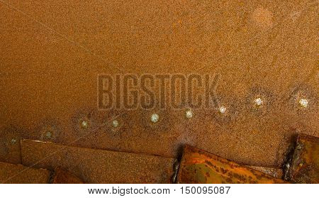 sheet metal somewhat rusty lying one upon another in three layers on one sheet of traces of spot welding in the form of bright points.