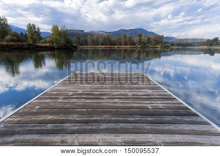 A wood dock by the Coeur d'Alene River near Cataldo Idaho.