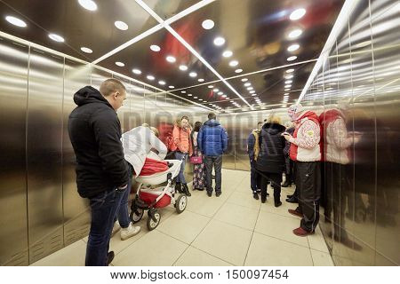 MOSCOW, RUSSIA - APR 02, 2016: Elevator cabin with passengers in Aviapark trade center at Hodynskiy boulevard.