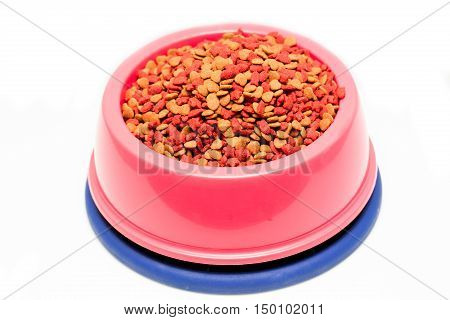 dry cat food in pink bowl isolated on white
