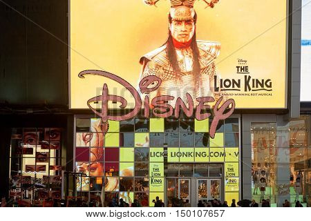 NEW YORK - CIRCA MARCH, 2016: Times Square Disney Store at night. Disney Store is an international chain of specialty stores selling only Disney related items, many of them exclusive.