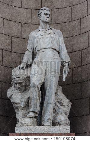 Minsk, Belarus - September 11, 2016: Sculpture of soviet man on the front side of National Museum