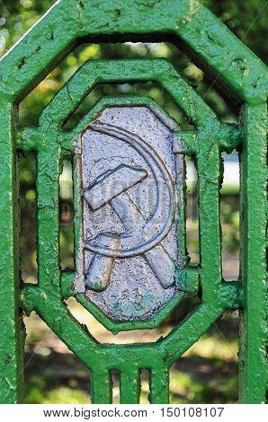 Minsk, Belarus - September 13, 2016: Soviet symbols (hammer and sickle) on the old metal fence