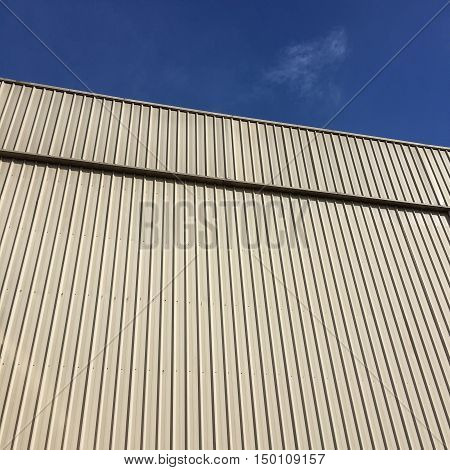 Straight lines of metal sheet siding Texture background.