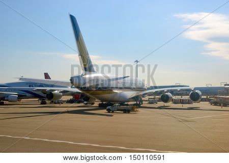 NEW YORK - MARCH 22, 2016: passenger jet airplane at JFK Airport. John F. Kennedy International Airport is a major international airport located in the borough of Queens in New York City.