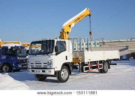 Great white auto truck crane standing on a construction site in winter - Russia Moscow - 21 January 2016