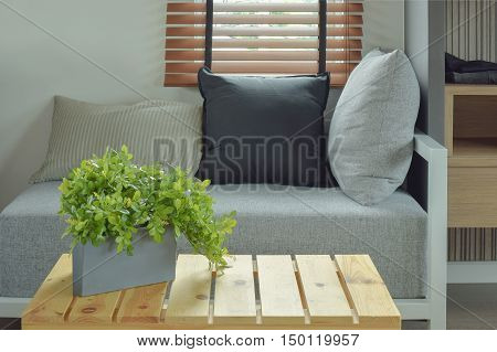 Plant Pot On Center Wooden Table And Comfy Seat In Living Room
