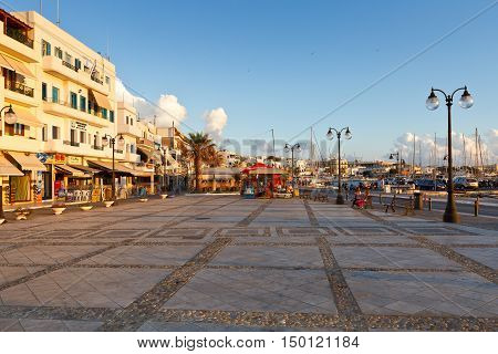 NAXOS, GREECE - SEPTEMBER 21, 2016: Restaurants and coffee shops at the seafront of Naxos town on September 21, 2016.