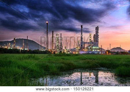 Twilight of oil refinery plant Oil plant at morning scene on cloudy background.