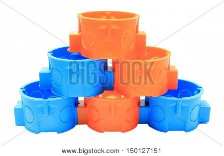 Stack Of Blue And Orange Electrical Boxes. White Background