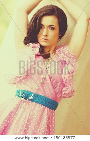 Fashion woman wearing pink dress