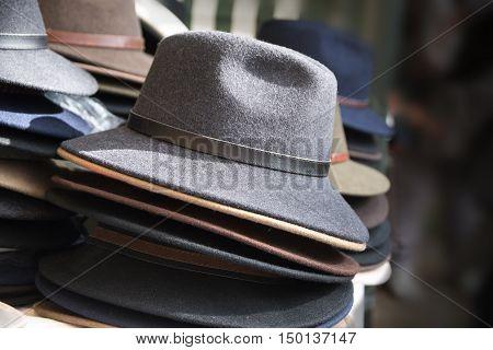 men's hats of felt for sale at a flea market selected focus and narrow depth of field