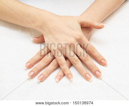 Beautiful female hands with french manicure close up