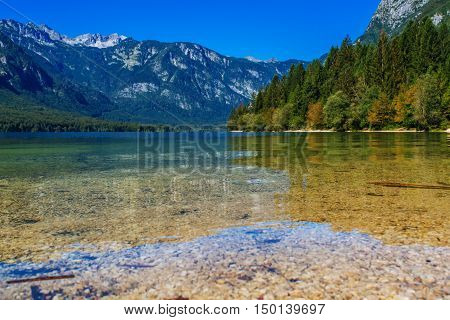 Bohinj lake in Slovenian national park Triglav with Julian Alps reflecting on surface