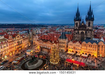 PRAGUE, CZECH REPUBLIC - DECEMBER 10, 2015: View from above on Tyn church, Christmas tree and traditional market in Old Town of Prague - famous and popular place with tourists during winter holidays.